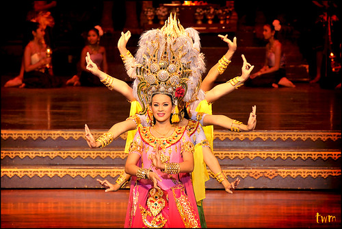 bbe740ae1 ... tapering headdresses, glamorous vibrant costumes and the graceful  movement of a group of performers define the attributes of Thai traditional  dancing.