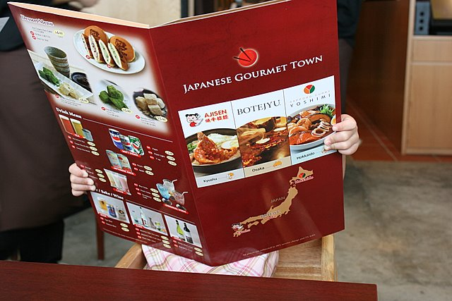 Nadine reading the menu