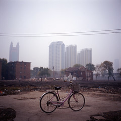 wide open (memetic) Tags: china 6x6 bicycle rolleiflex buildings uncut purple demolition  vanishing tianjin e100vs rubble  disappearing