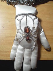 Chain maille 'Brown Recluse' handflower in red tiger's eye (hwkwlf) Tags: red brown black flower eye spider hand mail steel arachnid chain rings bracelet tigers hematite widow recluse stainless slave maille chainmaille hawkwolf