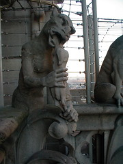 One of Notre Dame's gargoyles is eating the head of......a chicken? ...a deformed person? (Chris Devers) Tags: 2003 trip travel vacation sculpture paris france building art church monster statue stone architecture louis artwork europe honeymoon catholic ledefrance cathedral religion gothic eu christian notredame gargoyle demon hugo iledefrance notredamedeparis fra romancatholic parisfrance victorhugo frenchgothic archbishop ourlady ledelacit flyingbuttress artpiece violletleduc romancatholicchurch mauricedesully naturalism thehunchbackofnotredame exif:focal_length=55mm exif:exposure_bias=010ev exif:aperture=f28 exif:iso_speed=125 louisvii parisfra popealexanderiii desully camera:make=olympusopticalcoltd camera:model=c860ld360l exif:exposure=001sec1104 meta:exif=1257942590 exif:orientation=horizontalnormal exif:filename=dscjpg meta:exif=1350403823