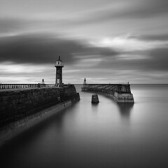 Whitby East Pier I (Adam Clutterbuck) Tags: ocean uk longexposure greatbritain sea england blackandwhite bw cloud lighthouse seascape monochrome clouds square landscape mono coast pier blackwhite wind cloudy unitedkingdom britain yorkshire north windy bn east coastal shore elements whitby gb bandw sq limitededition northyorkshire greengage adamclutterbuck sqbw bwsq showinrecentset shortedition le50 limitededition50