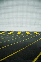 Showcase (partizan92) Tags: white abstract black abandoned lines yellow wall modern canon eos closed squares pavement geometry kentucky cinemas 5d louisville asphalt showcase shutdown