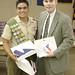 06-04 Dennis presents a Texas flag to Eagle Scout Chris Rubio.