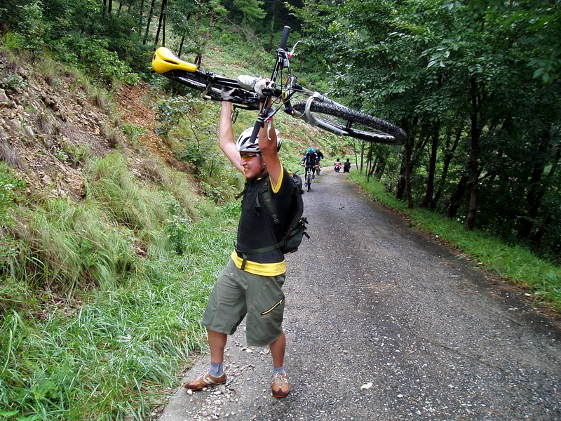 No matter you ride on a bike or a bike rides on you when you are crawling uphill