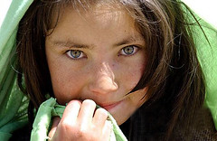 Hazara afghan (som sol'n frlt) Tags: people afghanistan girl smile face smiling children happy eyes pretty child shy medical aid hazel trust medicine freckles shawl taliban tear bagram afghani alqaida enduringfreedom