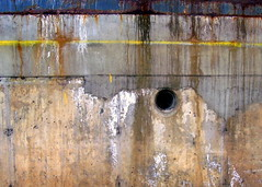 territorial pissings (Scribbles With Cameras) Tags: abstract metal concrete dock rust paint picasa drain damage corrosion cracked fragmented waterstains haphazartgrunge scribbleclick