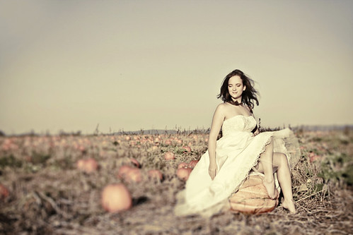 I love the look of this bride in a pumpkin patch What a perfect setting for