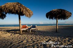 Cuba Day 6 - Sunrise Varadero (Ian Mears) Tags: ocean blue sea colour beach umbrella sunrise sand aqua shadows seascapes turquoise cuba cyan bluesky varadero sunlounger