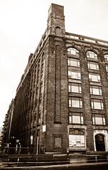 "When ""sweatshops"" were just called ""factories."" (Chris Beauchamp) Tags: blackandwhite building boston sepia architecture canon factory wharehouse xti copyrightchrisbeauchamp20072009"