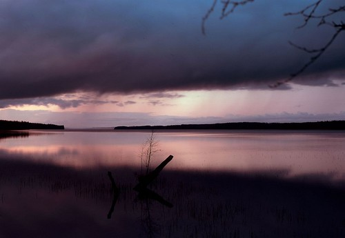 Dark lake in the rain at sundown