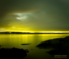 Open your green eyes (mortenprom) Tags: ocean longexposure autumn light sunset sea sky panorama sun black color reflection green fall beach nature water yellow oslo norway stone clouds dark landscape golden evening norge rocks skandinavien norwegen wideangle explore noruega scandinavia 2008 oslofjord malmya noorwegen noreg wideangel sigma1020mm nesodden skandinavia nesoddtangen canoneos40d platinumheartaward damniwishidtakenthat mortenprom