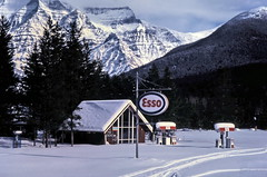 gm_13213 Mount Robson Snow and Esso Gas 1976 (CanadaGood) Tags: bc britishcolumbia mountrobson analog mountain tree gasstation snow 1976 esso slidefilm mountrobsonpark kodachrome rockymountains rockies slidecube red white highway highway16 colour color geology sign building canadagood canada best favourite seventies text