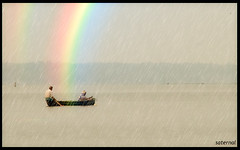 Working through the rainbow (saternal) Tags: rain rainbow fishing fishermen kerala aplusphoto saternal