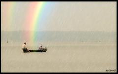 Working through the rainbow (saternal) Tags: rain rainbow fishing fishermen kerala aplusphoto saternal