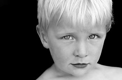 Arresting eyes (trevor.richter) Tags: boy portrait blackandwhite eye 20d face canon 50mm availablelight naturallight blond f18 top20childrensportraits