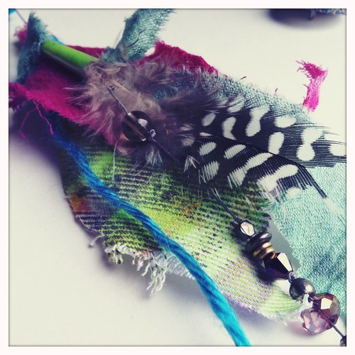 hand dyed fabric, feathers, swaroski crystals and beads