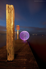 long shadows (~ jules ~) Tags: wood longexposure pink blue light red sea lightpainting night clouds ball circle stars pier globe julian nikon paint shadows purple jetty orb sigma marshall sphere round jules lightpaint lapp d300s jayemphotography