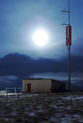 February moon (_olasso) Tags: longexposure blue sky moon cold grass backlight night clouds dark iceland lowlight nikon moody darkness calm fullmoon moonlight serene shack northern shining radiomast kpavogur d40x