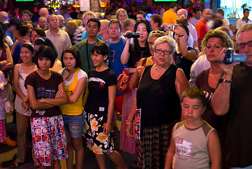 Tourists watching ladyboys on Phuket.