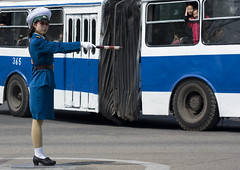 Pyongyang bus and trafic officier - North Korea (Eric Lafforgue) Tags: pictures street travel bus car photo war asia outdoor picture korea kimjongil korean asie coree journalist journalists northkorea nk ideology axisofevil dictatorship  eastasia  dprk  coreadelnorte stalinist juche kimilsung northkorean 6107 nordkorea lafforgue  democraticpeoplesrepublicofkorea  ericlafforgue   koreanpeninsula coredunord  coreadelnord   dpkr northcorea juchesocialistrepublic coreedunord rdpc  stalinistdictatorship jucheideology insidenorthkorea  rpdc   demokratischevolksrepublik coriadonorte  kimjongun coreiadonorte
