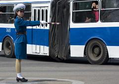 Pyongyang bus and trafic officier - North Korea (Eric Lafforgue) Tags: pictures street travel bus car photo war asia outdoor picture korea kimjongil korean asie coree journalist journalists northkorea nk ideology axisofevil dictatorship  eastasia  dprk  coreadelnorte stalinist juche kimilsung northkorean 6107 nordkorea lafforgue  democraticpeoplesrepublicofkorea  ericlafforgue   koreanpeninsula coredunord  coreadelnord   dpkr northcorea juchesocialistrepublic coreedunord rdpc  stalinistdictatorship jucheideology insidenorthkorea  rpdc   demokratischevolksrepublik coriadonorte  kimjongun coreiadonorte