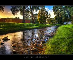 Creek at Campbelltown - HDR (Artie | Photography :: I'm a lazy boy :)) Tags: park trees sunset sky colour nature water creek photoshop canon bravo rocks colours cs2 stones tripod kitlens australia pebbles adelaide grasses ripples 1855mm southaustralia efs neighbourhood hdr campbelltown artie 3xp photomatix tonemapping tonemap 400d rebelxti
