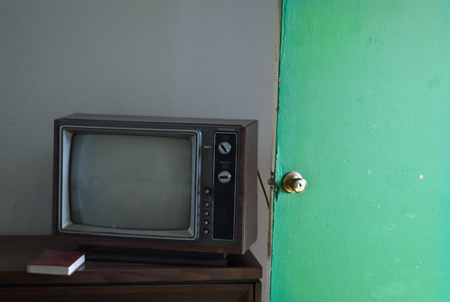 old tv with open door @ chinook motel