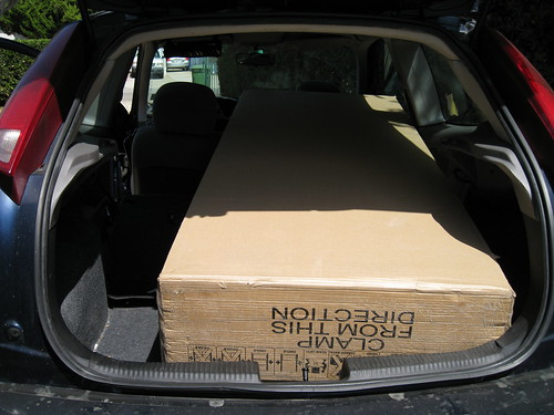 treadmill in box in back of 2000 Ford Focus hatchback