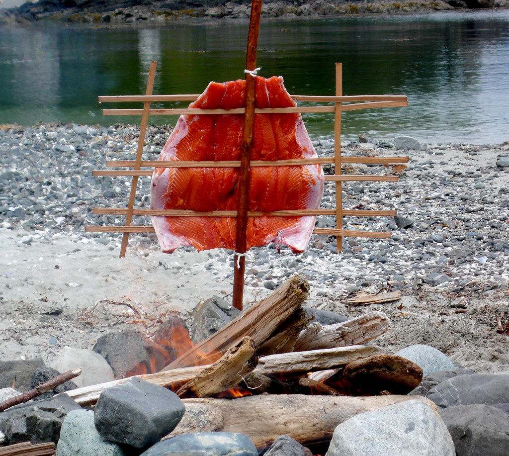 Salmon the traditional way with dugout canoe in the background, Clayoquot Sound Vancouver Island