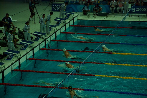 There he is! Michael Phelps in the lead in the white cap.