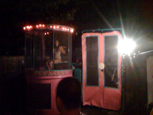 Hot girl in a dunk tank. wearing bikini bottoms and a wet white t-shirt