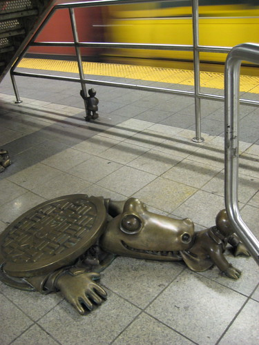 Alligator eating Money Sculpture 14th Street - New York Subway