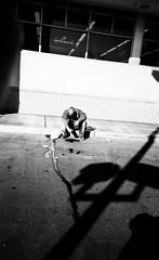 Frozen (LoFiKen) Tags: street las vegas light urban blackandwhite bw white man black hot cold film ice water photography frozen blood shadows nevada 28mm streetphotography natura lamppost tired weathered splash spill premium dripping hallmark classica arista 123bw