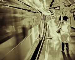 We are all passengers, but most times we can choose the train upon which we ride (photocillin) Tags: motion art station digital train underground transport tube platform wait passenger boarding solarise