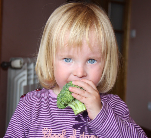Nora eating broccoli