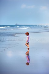 Reflected Beach Girl (Rebecca812) Tags: ocean blue vacation sky seascape reflection cute girl hat clouds walking fun pier kid sand waves child play daughter onthemove strawhat swimmingsuit wetsand canon5dmarkii rebecca812 heritage2011