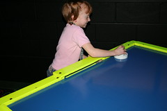 Mattey playing air hockey