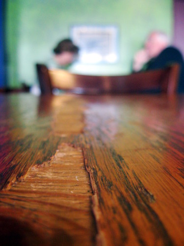 weathered table and worn out conversation.
