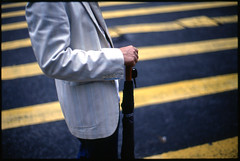 Direction (AAGCTT) Tags: china man film umbrella hongkong candid central suit expired  nikonf3hp zebracrossing   kodakektachromeepp100 carlzeissplanar50mmf14zf