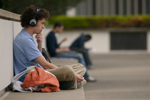 A young man listening to books on tape.