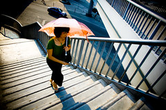 A smartly dressed  woman carrying a parasol climbs up the steps (morf*) Tags: guangzhou china woman concrete grey flickr footbridge steps pedestrian parasol guangzhouchina huansha