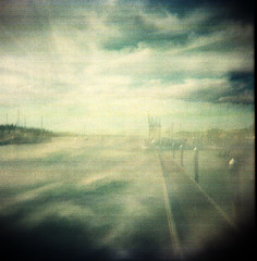 Brume of Brine (Dead  Air) Tags: ocean sea sky water clouds port dark boats bay holga dock haze brine expressionism olympia impressionism overexposed pugetsound hazy murky brume exposures murk bulbsetting buddbay