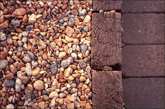 brighton beach #1 (chirgy) Tags: wood 35mm brighton pebbles scan textures lookdown transparency analogue velvia100 pentaxespio120