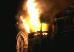 TERROR STRIKES AGAIN : Hotel Taj Mahal, Mumbai being burnt due to bombings and firings on the late wednesday night of 26th November. (Stuti ~) Tags: india flames attack terror mumbai