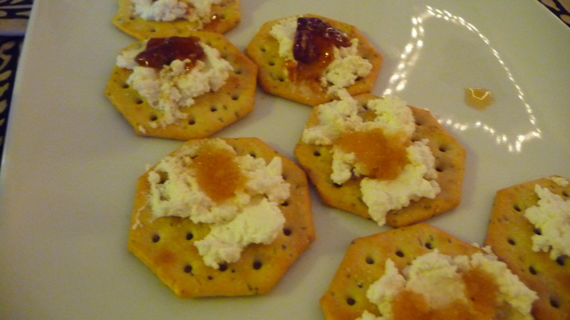 Ricotta cheese on rosemary crackers