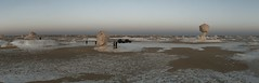 Mushroom monolith panorama (sonofwalrus) Tags: africa sunset people panorama white slr cars canon chalk desert dusk egypt middleeast stitched monoliths  whitedesert eos400d
