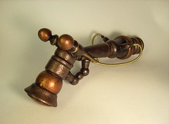 Old Vic Retro Steampunk Ray Gun 4 (Builders Studio) Tags: christmas wood fiction sculpture mars art classic window self trek comics toy death star mirror miniature necklace punk gun ray technology hand view geek arm tech space painted side alien rear rifle decoration mini jewelry science ufo retro steam nasa replica suncatcher ornament weapon pistol scifi laser hanging stunner pulp wars rogers buck dangle hang defense prop pendant martian geekery raygun invaders blaster phaser steampunk