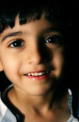 They will always remember  your smile (FatoOoma Qatar ~) Tags: lighting camera boy portrait baby white man cute male men guy love smile face smiling canon logo happy person lights photo flickr day image little young picture human smiley cousin 2008 fatma doha qatar smiler chlid smiled flickcom 400d 5alid fatoooma khaild 5lodii