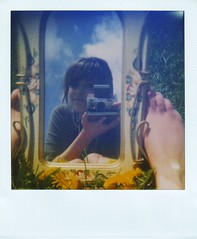 Everyone needs a mirror shot (Kate Pulley) Tags: camera blue film feet me polaroid sx70 mirror spring kate filter 600 nd land hmm dandelions redlomo oddproportions actualcolors thoughmyscannerstinks